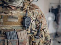 Military man with radio in pocket